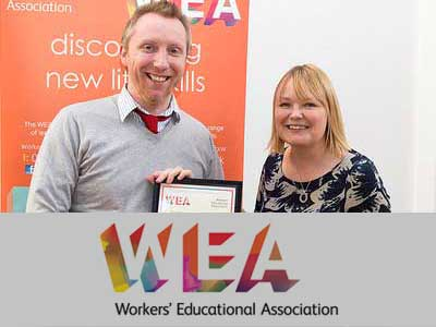 November 2014: Nadine Dereza Presenting WEA Innovation and Contribution Award to Adam Bracher